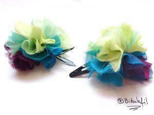 2 pompons en tissu